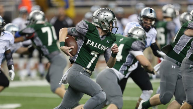 Grand Rapids West Catholic's Nic Baker runs against Lansing Catholic during first half action in the Division 5 state championship game on Saturday, November 29, 2014 at Ford Field.