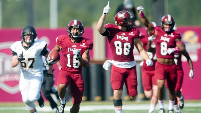 Troy wide receiver Chandler Worthy (16) returns a kick off 99 yards for a touchdown during the NCAA football game between Troy and Appalachian State on Saturday, Oct. 18, 2014, at Larry Blakeney Field in Troy, Ala.