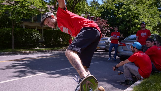 Cameron Yager of Greece kills time with friends of Roc City Skatepark before rolling down Park Avenue en masse last summer to show support for building a skatepark in Rochester.