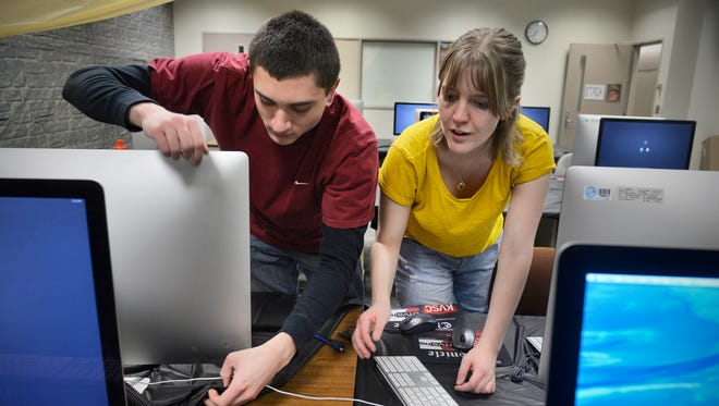 St. Cloud State University mass communications students Nick Borzych and Samantha McIntosh help set up for a previous KVSC 88.1 FM trivia weekend.