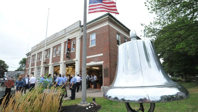 Braintree firefighters gather at Braintree Fire Department headquarters for a 9/11 memorial service marking the 19th anniversary of the 2001 terrorist attacks, Friday, Sept. 11, 2020. Tom Gorman/For The Patriot Ledger