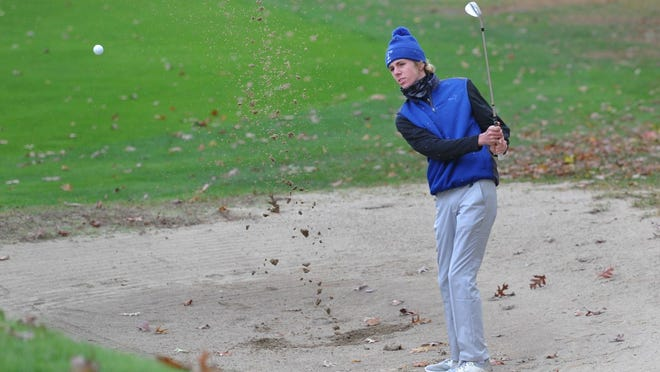 Scituate's Austin Ryan digs a shot out of the bunker. Scituate won the team championship during the Patriot League Golf Tournament at the Pembroke Country Club, Tuesday, Nov. 3, 2020. Tom Gorman/For The Patriot Ledger