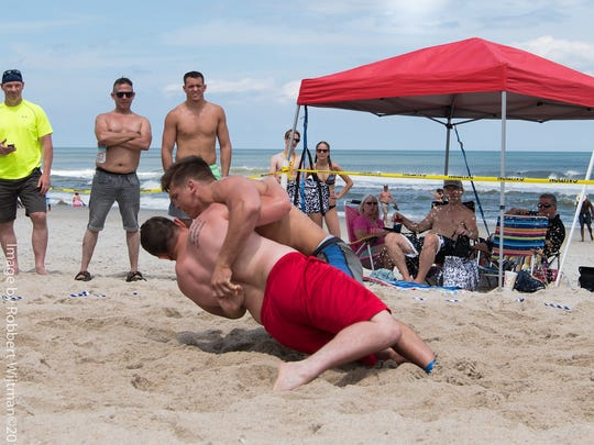 Beach Nationals champion Jacob Kasper of Lexington takes down one of his four opponents in the USA Wrestling endorsed event.