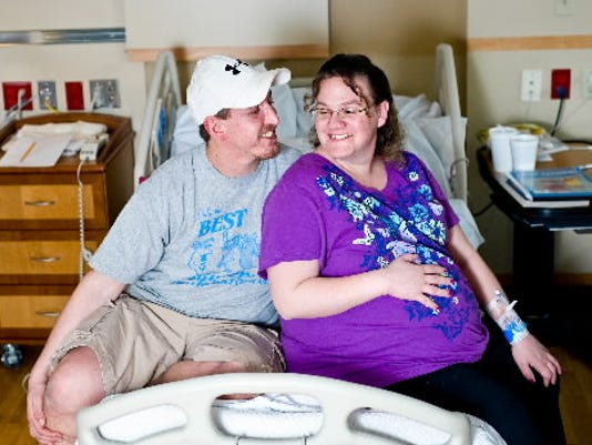 This March 1 file photo shows Greg and Heather Toomey at York Hospital. Heather gave birth to the couple's quadruplets on Saturday.