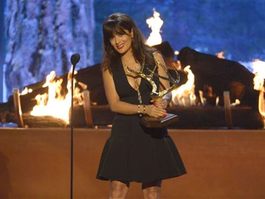 """Salma Hayek accepts the """"Decade of Hotness"""" award at the 2015 Spike TV's Guys Choice Awards at Sony Studios on Saturday, June 6, 2015, in Culver City, Calif.  (Photo by Phil McCarten/Invision/AP)"""