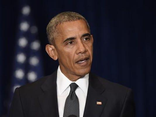 Obama+US+Shooting_Wood.jpg