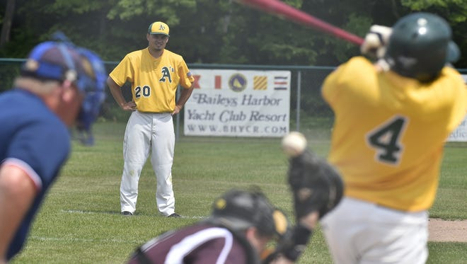 Baileys Harbor coach Derek Niedzwiecki watches as A's batter Lucky Stephenson fouls off a pitch against host West Jacksonport.