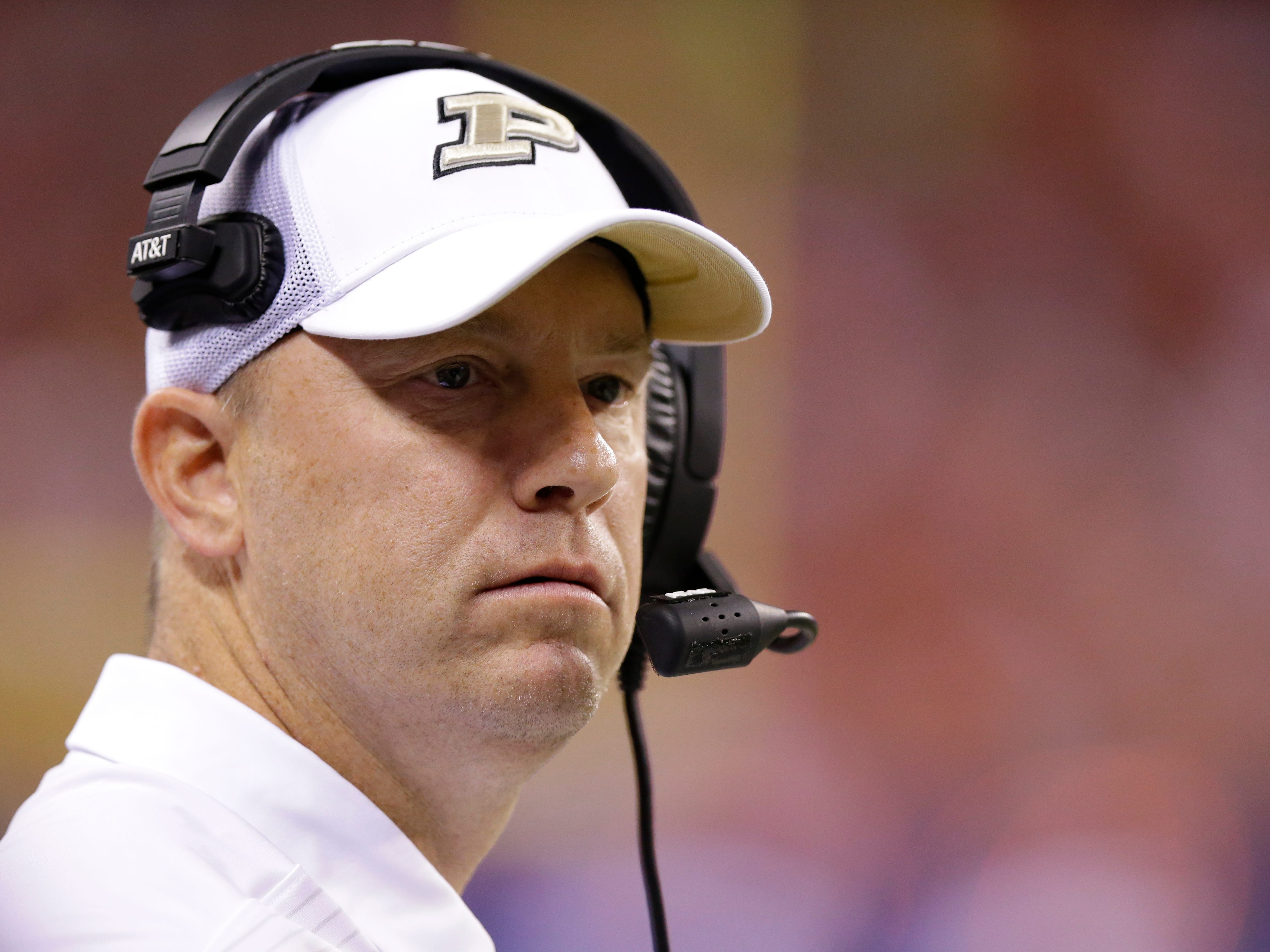 FILE - In this Saturday, Sept. 2, 2017 file photo, Purdue head coach Jeff Brohm yells from the sideline as his team played against Purdue during the first half of an NCAA college football game in Indianapolis. Jeff Brohm came to Purdue to win. The first-year coach still believes he can even with some midseason missteps. Nebraska coach Mike Riley understands. The Boilermakers and Cornhuskers have both lost back-to-back games. They both need three wins to become bowl eligible. And both know that the turnaround must begin Saturday night, Oct. 28, 2017 in West Lafayette, Indiana. (AP Photo/Michael Conroy, File)