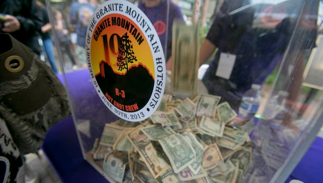 Money is collected at the entrance to Whiskey Row during Prescott Strong, a benefit that was held for the families of the Granite Mountain Hotshots and the Yarnell residents who lost their homes.