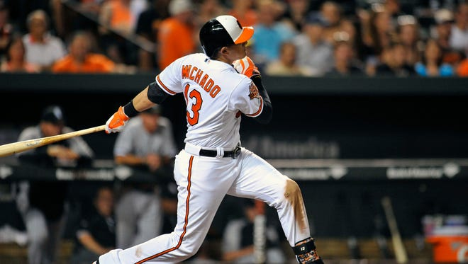 Baltimore Orioles third baseman Manny Machado (13) singles in the seventh inning against the Chicago White Sox at Oriole Park at Camden Yards. The White Sox defeated the Orioles 4-2.