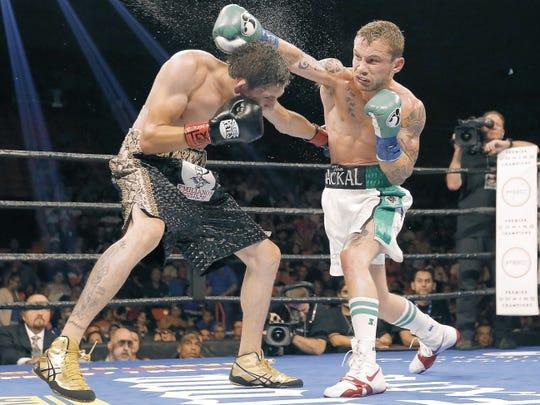 Irish boxer Carl Frampton successfully defended his