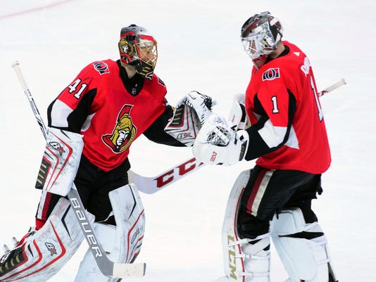 Ottawa Senators goaltender Craig Anderson, left, gets replaced by Mike Condon during the second period of an NHL hockey game, Tuesday, Jan. 9, 2018, in Ottawa, Ontario. (Sean Kilpatrick/The Canadian Press via AP)