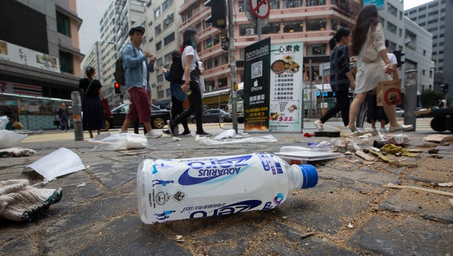 A plastic sports drink bottle lies discarded on the street in Kwun Tong, Kowloon, Hong Kong, Dec. 6, 2018. Hong Kong's leading beverage producers and bottlers representing around half of all bottled water and soft drinks sold in the city joined with major Hong Kong retailers, recyclers and NGOs to announce a new campaign called 'Drink Without Waste'.