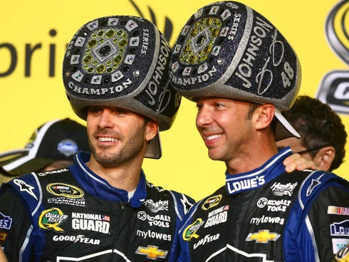Sprint Cup Series driver Jimmie Johnson (left) celebrates with crew chief Chad Knaus after winning his sixth NASCAR championship.
