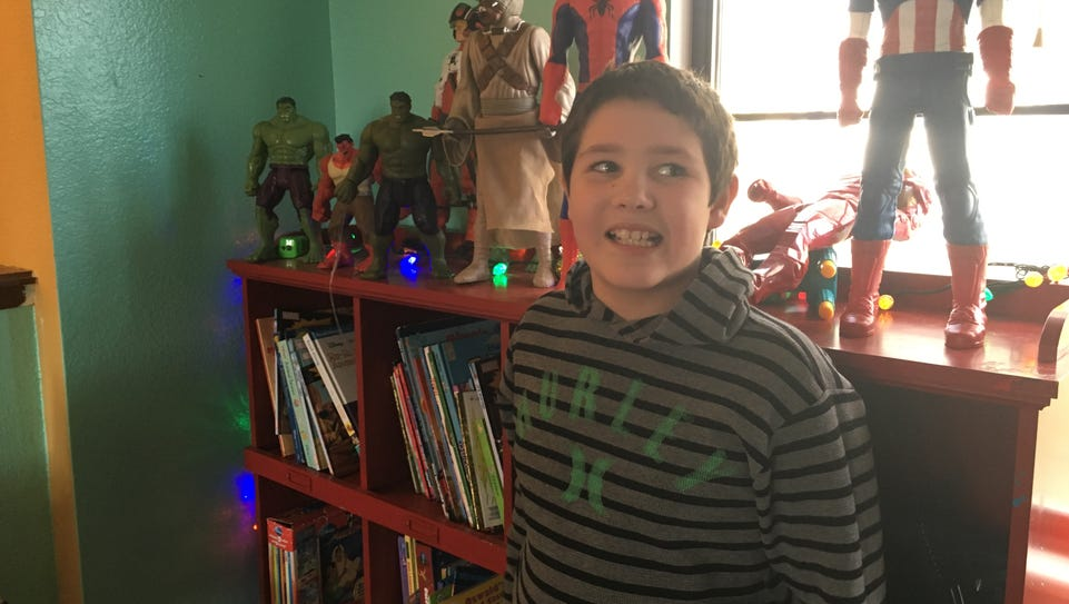 Peyton Sinclair,10, stands in his Sparks home on Dec.