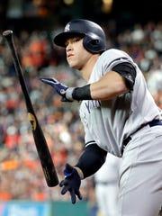 New York Yankees' Aaron Judge tosses his bat after