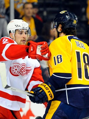 Detroit Red Wings defenseman Brendan Smith (2) and Nashville Predators left winger James Neal (18) exchange words during the first period at Bridgestone Arena.