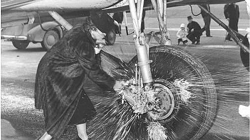 "Blanche Sprague, wife of Oregon Gov. Charles Sprague, christens a United Air Lines plane as the ""City of Salem"" on Dec. 5, 1941."