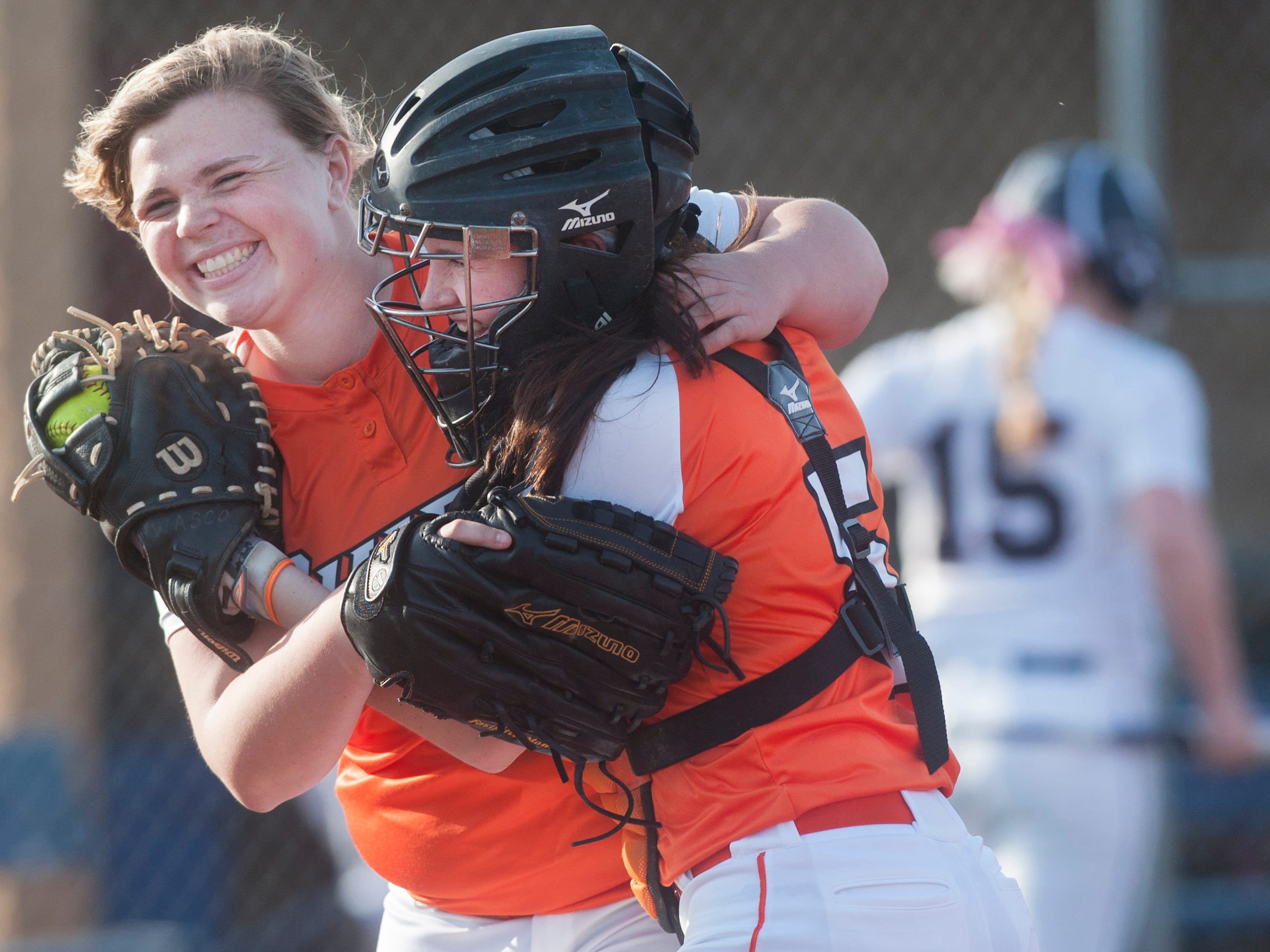 Cherokee pitcher Abbey Scarengelli, left, celebrates with Cherokee catcher Brooke Wasco at the end of Mondays softball game between Cherokee and Eastern, played at Eastern High School in Voorhees. Cherokee won 5-4. 04.14.15