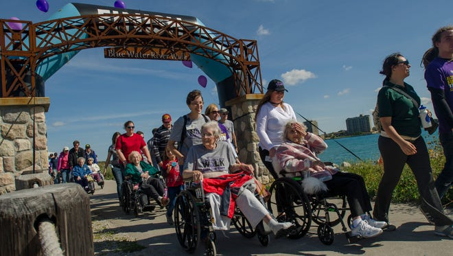 Participants start their walk Sunday, Sept. 25, 2016, during the Alzheimer's Walk along the River Walk in Port Huron.