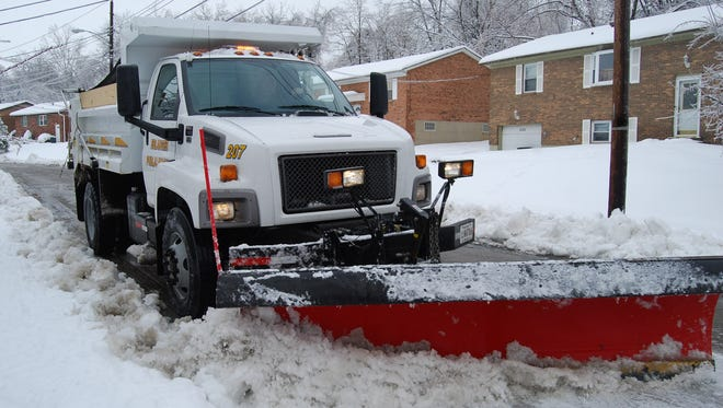 An Erlanger public works truck plows a street in the Cherry Hill subdivison in 2010.