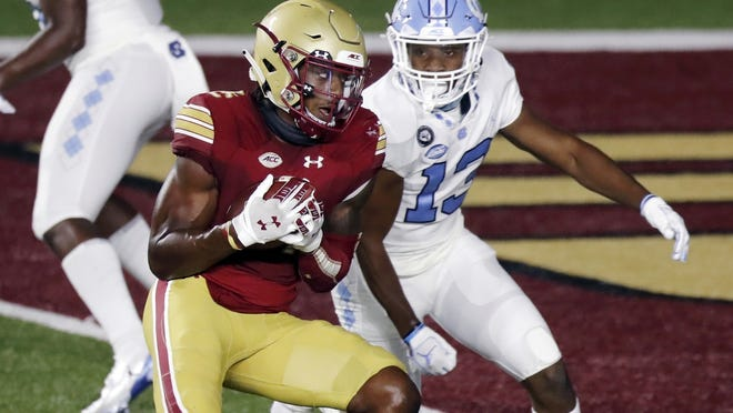 Boston College wide receiver CJ Lewis makes a touchdown reception against North Carolina defensive back Obi Egbuna in the second half of Saturday's game.