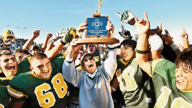 The 1971 Mayfield High School football state championship team celebrates its 50th anniversary this year. It was the first of the Trojans' eight state titles. This photo shows Mayfield winning a title in the early 2000s.