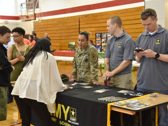 Representatives of the U.S. Army share information