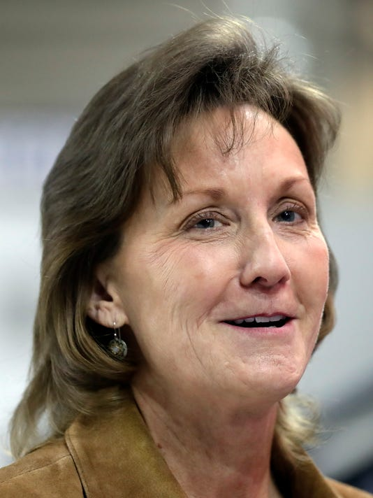 Conference USA Commissioner Judy MacLeod responds to a reporters question during an interview on the first day of the men's and women's basketball tournament at the Ford Center in Frisco, Texas, Wednesday, March 7, 2018. (AP Photo/Tony Gutierrez)