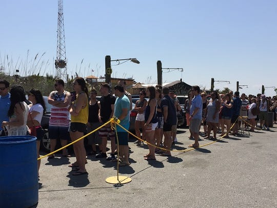 This May 28, 2016 photo shows a long line at the popular Ocean City restaurant and entertainment venue, Seacrets on 49th Street. Business was brisk and skies were sunny for the unofficial launch of the summer season at area resorts.