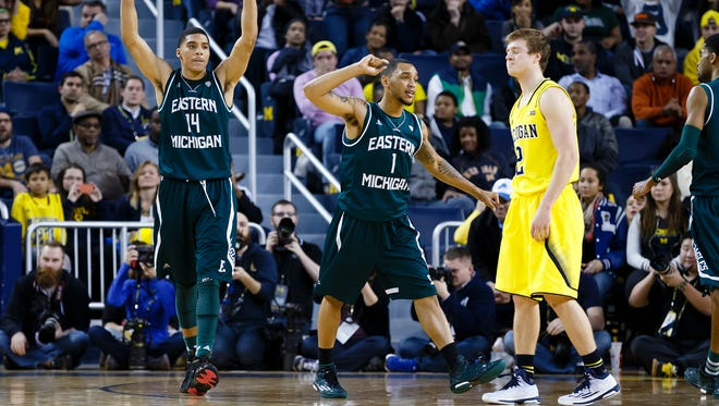 Eastern Michigan players react from the court in front of Michigan guard Spike Albrecht in the second half at Crisler Center.