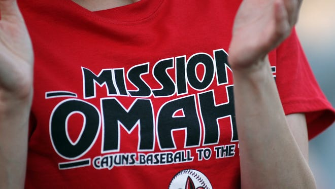 """A fan wears a """"Mission Omaha"""" shirt while watching UL play Jackson State Friday, May 30, 2014, during the NCAA Division I Baseball Regional Tournament at M. L. """"Tigue"""" Moore Field in Lafayette, La. Jackson State won 1-0."""