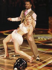 """Alfonso Ribeiro and Witney Carson compete on the finale of 'Dancing With the Stars."""""""