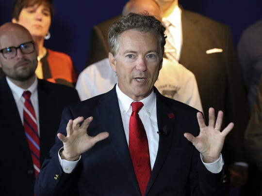 Senator Rand Paul talks about his support for repealing Obamacare while promoting a restructuring of group health insurance during a speech at the River House Restaurant.