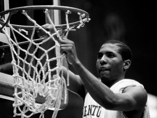 Kentucky's  Dicky Beal cuts down the net after the Wildcats defeated Auburn in the SEC championship game at Vanderbilt University. Photo by Ricky Rogers (The Tennessean) 3/10/84