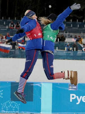 Kikkan Randall (USA) and Jessica Diggins (USA) celebrate winning the gold medal in the ladies' cross-country skiing team sprint freestyle final during the Pyeongchang 2018 Olympic Winter Games at Alpensia Cross-Country Centre.
