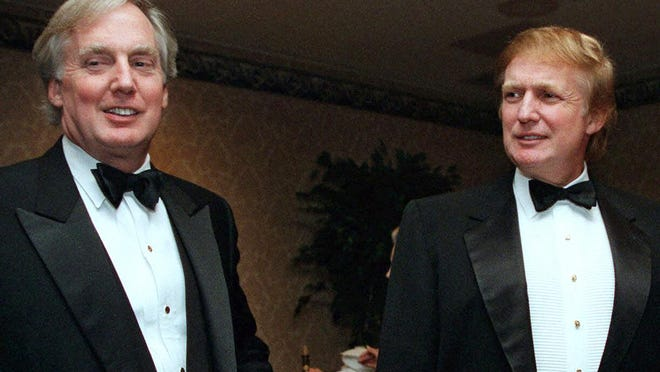 In this Nov. 3, 1999, file photo, Robert Trump, left, joins real estate developer and then-presidential hopeful Donald Trump at an event in New York. Robert Trump died Saturday night at age 71, the president said in a statement. [AP, file / Diane Bonadreff, File)