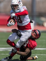 Southern Utah University Conerback Taelin Webb stops Wide Receiver Darrion Alton during a scrimmage at Eccles Coliseum Saturday, March 31, 2018.