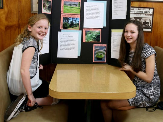 Claire Campbell, left, and Julia Meyers provided plenty of evidence of the risk of invasive species in Oregon.