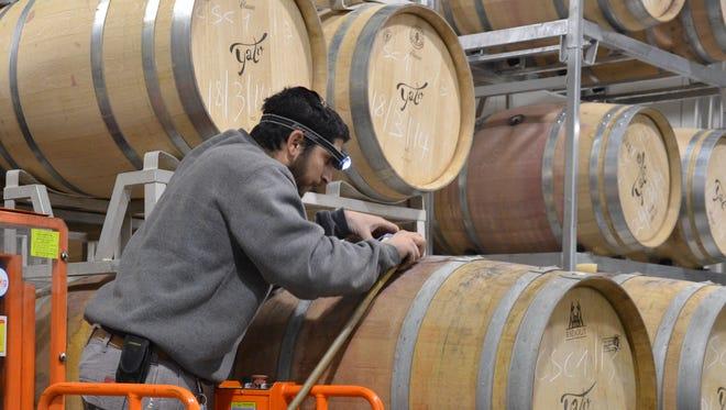 Kosher worker filtering the 2013 viognier, which will make 14,000 bottles.