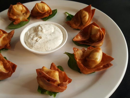 Green chile chicken wontons ($6.50), fried and steamed at Cafe A Go Go.
