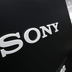 Visitors walk past a logo of Sony at Sony Building in Tokyo Thursday, July 31, 2014.