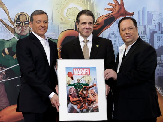 In this Feb. 26, 2014 photo, Disney CEO Bob Iger, left,