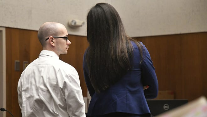 Aaron Rowe and his attorney JudyAnneRogado speak before his case continues.