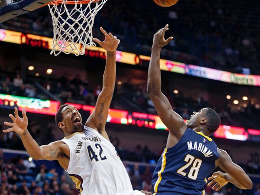New Orleans Pelicans center Alexis Ajinca (42) and Indiana Pacers center Ian Mahinmi (28) battle under the basket during the second half of an NBA basketball game in New Orleans, Friday, Jan. 8, 2016. The Pacers won 91-86. (AP Photo/Gerald Herbert)