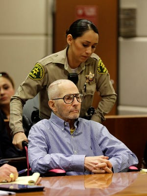 In this Dec. 21, 2016 file photo, real estate heir Robert Durst is brought into a courtroom in a wheelchair for a hearing in Los Angeles. Before a judge even decides if there's enough evidence to try Durst on an old murder charge, prosecutors plan to start taking testimony. In a rare hearing Tuesday, Feb. 13, 2017, two witnesses will be called to the witness stand against Durst in Los Angeles Superior Court to preserve their testimony in case it is needed later.