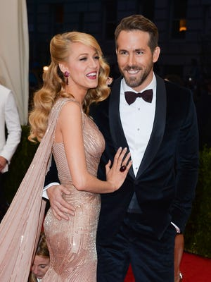 Actress Blake Lively is pictured with her husband Ryan Reynolds. She is a fan of Askinosie Chocolate.