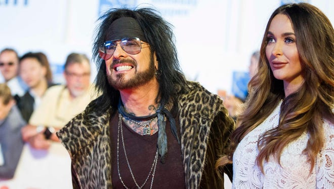 Nikki Sixx of Motley Crew and his wife Courtney pose for photographers during the premiere of the film 'Long Time Running'  on Thursday.