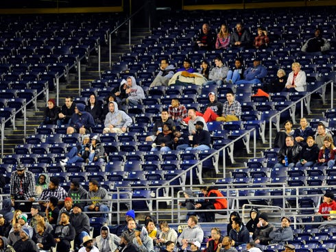 Fans look on during the first half of the 2013 Poinsettia Bowl between the Northern Illinois Huskies and Utah State Aggies in San Diego on Dec. 26. While the five bowl games that comprise the Bowl Championship Series are typically hot tickets, the av