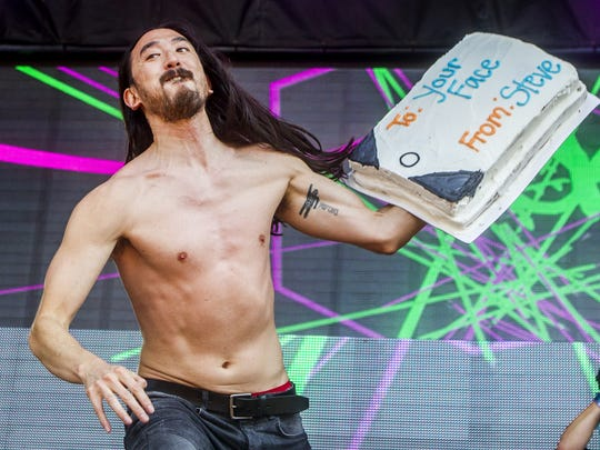 Steve Aoki tosses a cake at The Backyard stage at Firefly